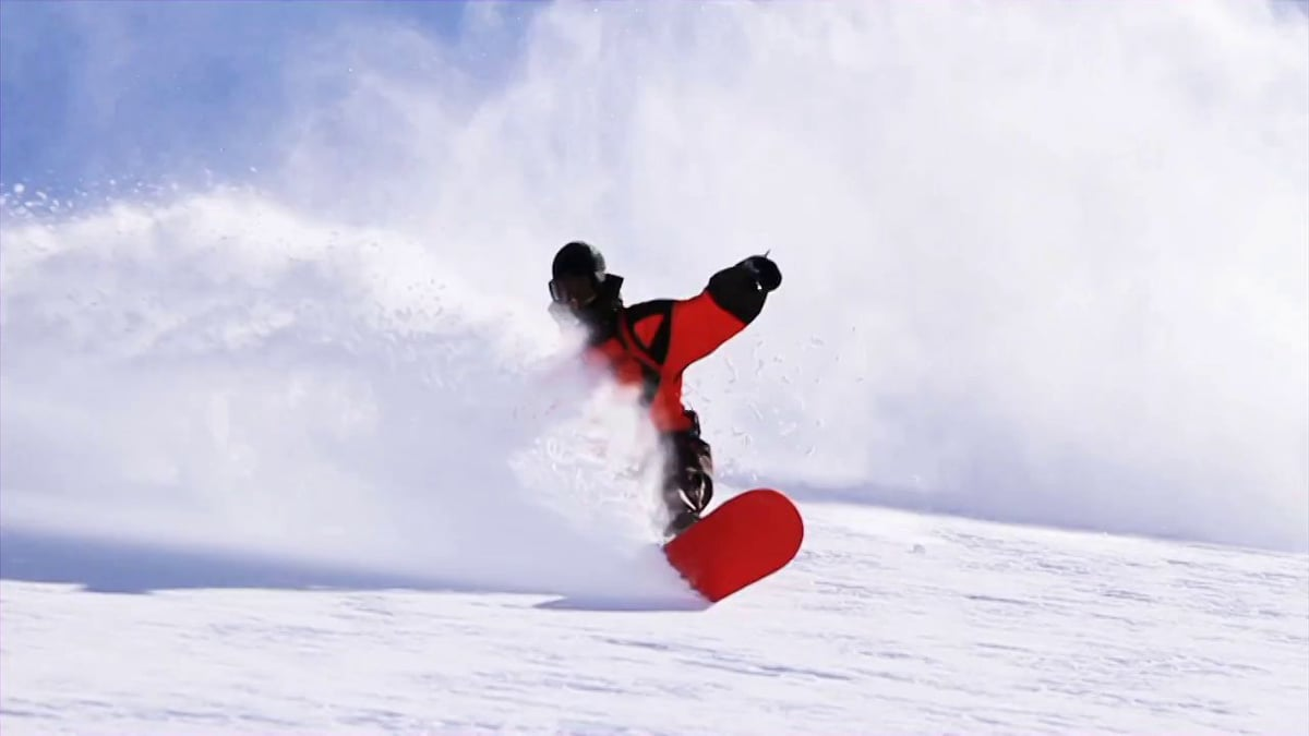 snowboarding powder turn