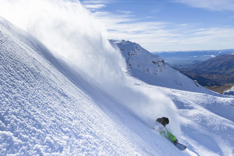 snowboarder powder turn photo