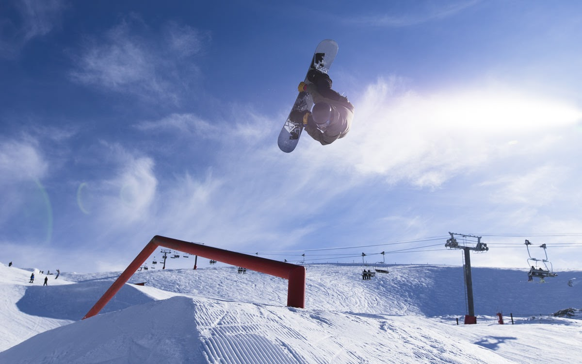 carlos garcia knight backflip off rail on snowboard