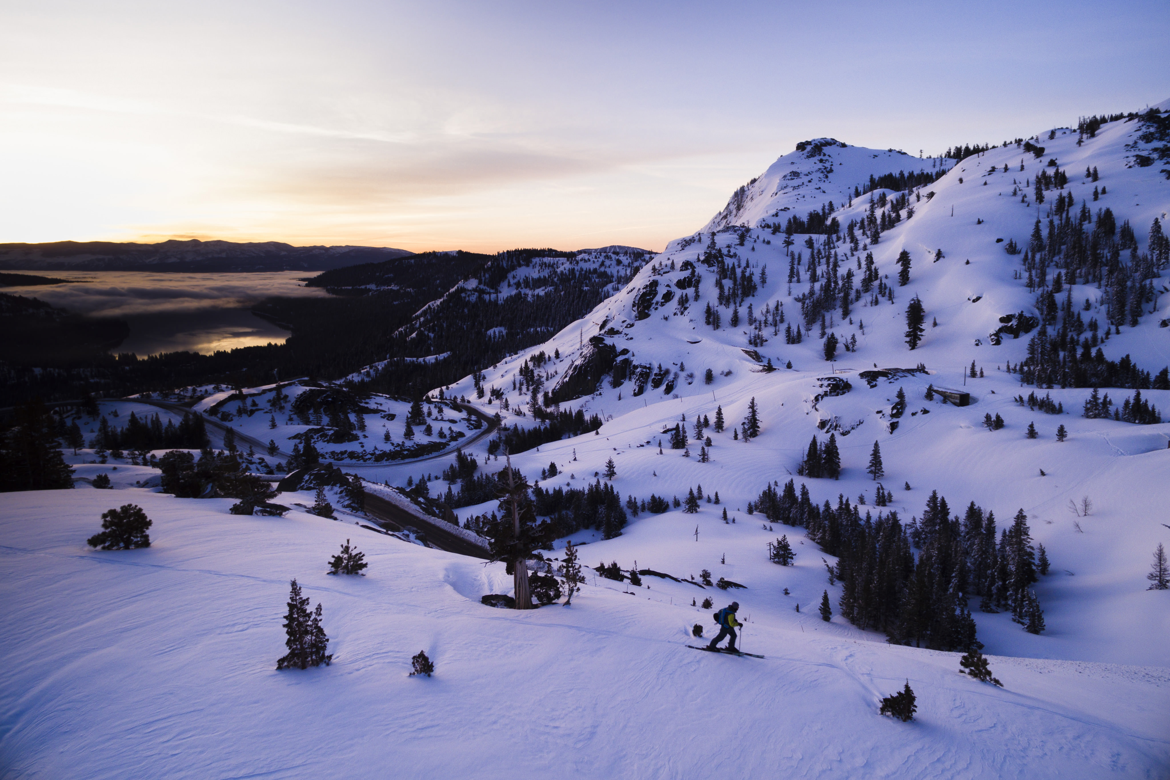 skier in the morning light from a drone
