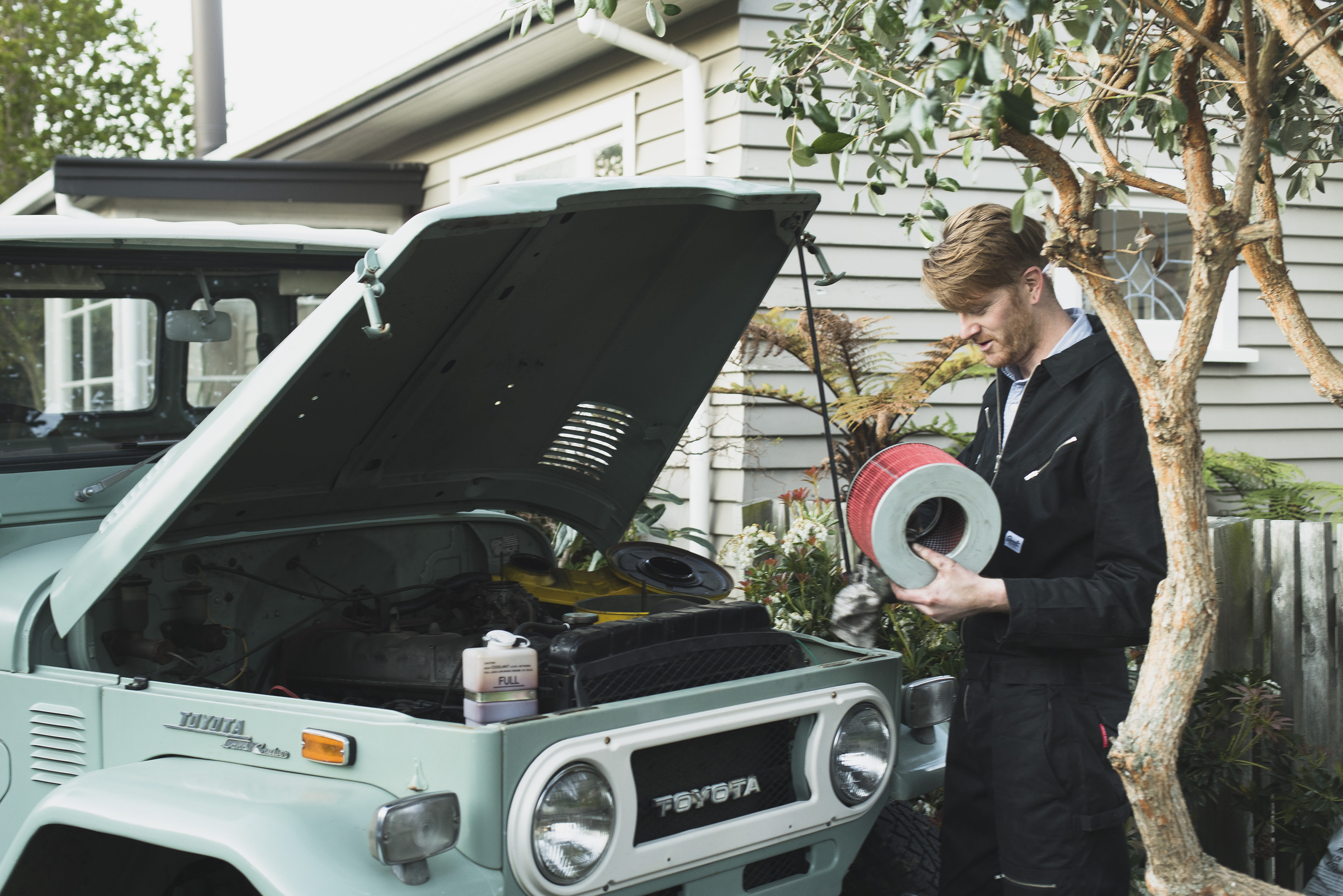 earnest overalls working on a land rover