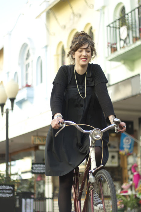 girl riding a bicycle in a christchurch street