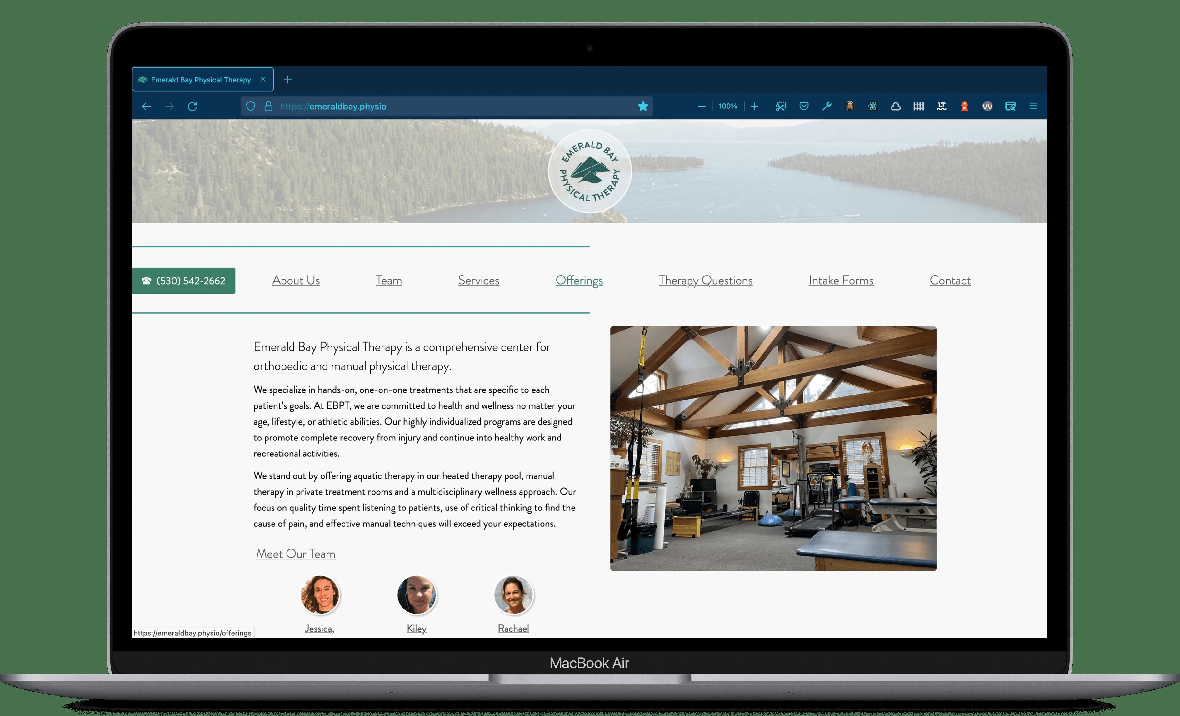emeraldbay.physio website being displayed on a MacBook Air