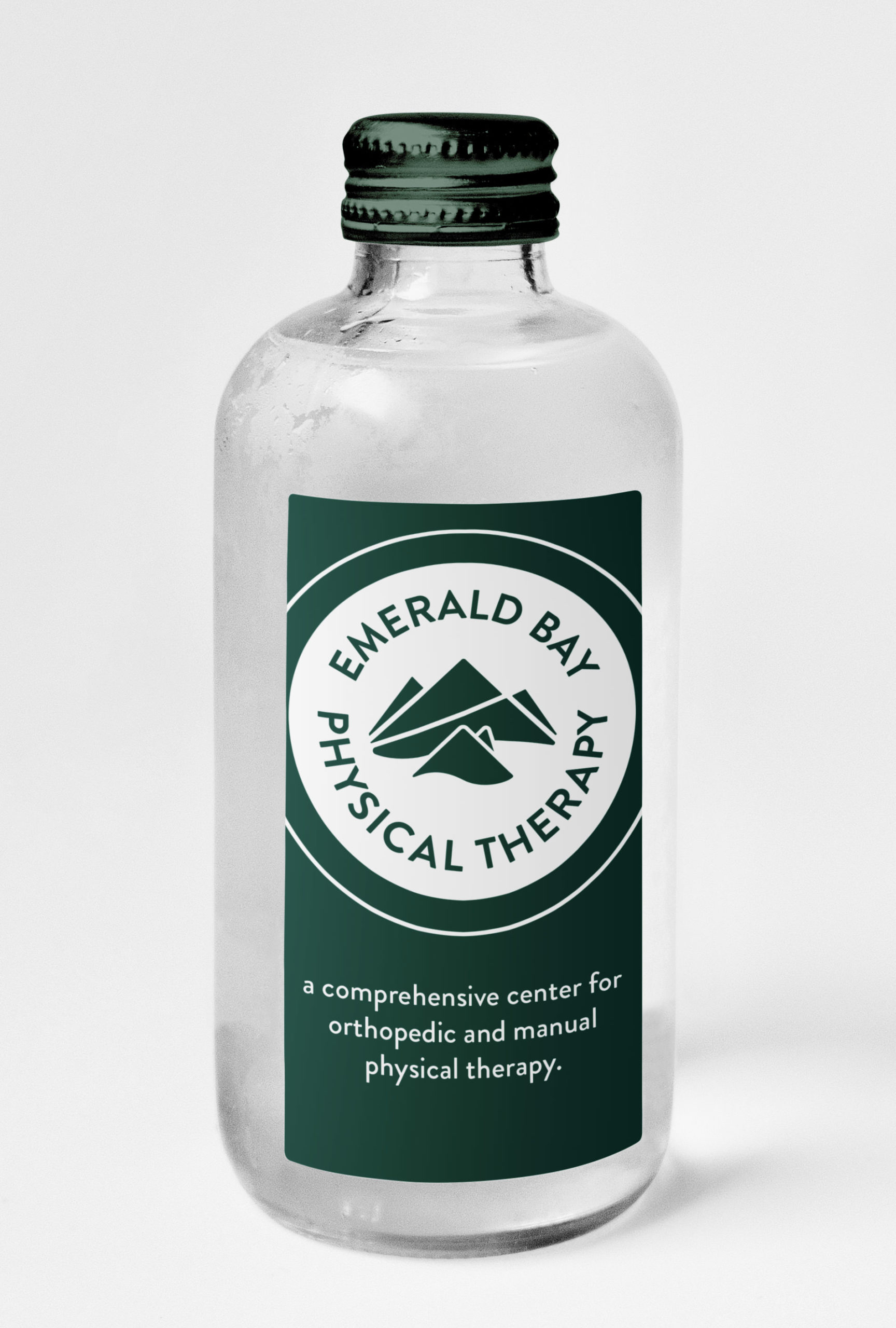 emerald bay physical therapy branding on a glass bottle